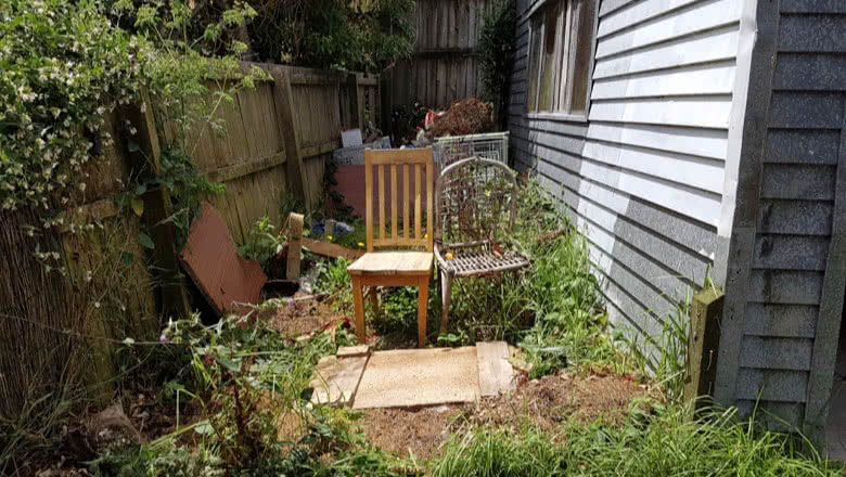 Rubbish in garden of home Auckland